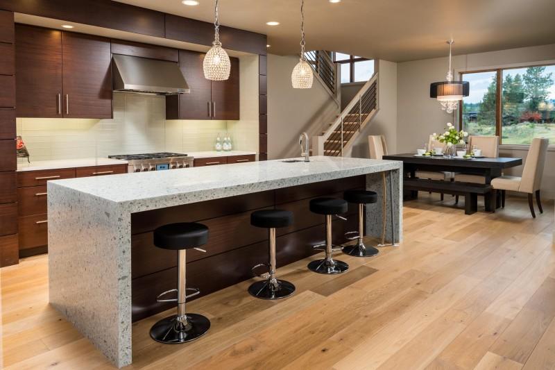 modern kitchen with waterfall edge countertop