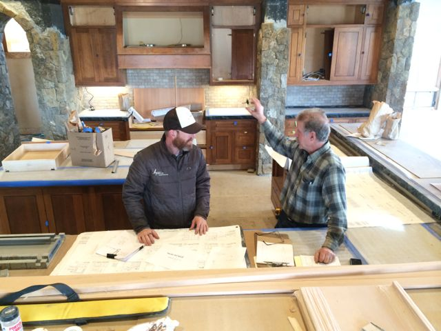Looking at plans during the Custom Home Construction Process